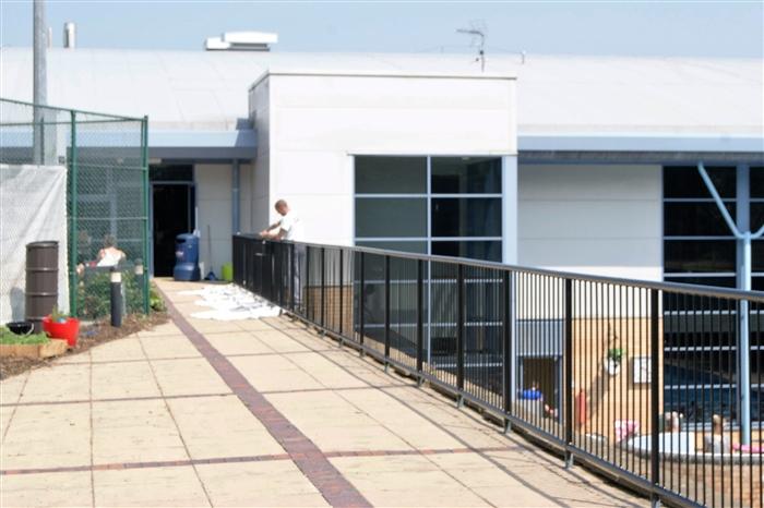 1.-Terrace-railings-being-prepared-for-painting
